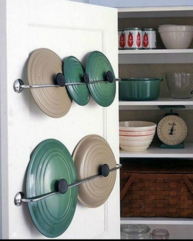 крышки крепятся к дверцам кухни держателем для полотенец